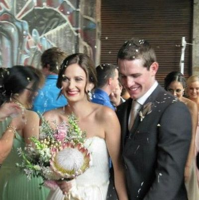Image of happy bride and groom during wedding ceremony.